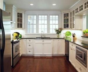 Phòng bếp sáng sủa và rộng rãi hơn khi tone chủ yếu sử dụng là tone trắng, sau sửa phòng bếp nhà ống.
