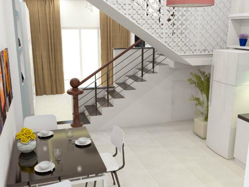 Phòng ăn nhỏ xinh, bên cạnh cầu thang với mảng tường màu xám làm điểm nhấn cho không gian thêm sinh động, sau khi xây sửa nhà ống này.