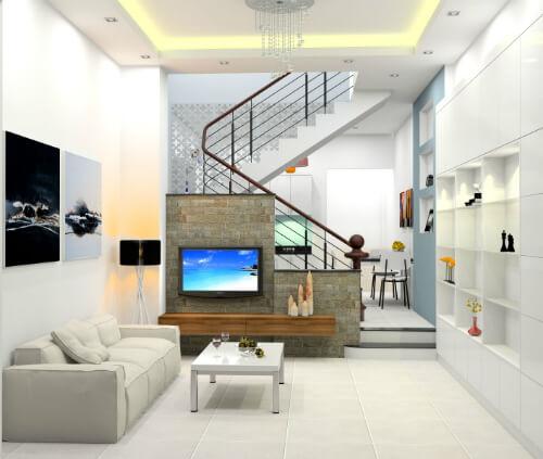 Xây sửa nhà ống với phòng khách với tông màu trắng chủ đạo, thoáng sáng, tạo cảm giác rộng rãi hơn.