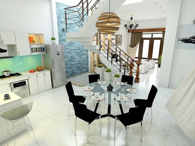 Phòng khách và bếp ăn ngăn cách bởi bức vách gỗ thưa và cầu thang. Dưới gầm cầu thang bố trí tiểu cảnh nhỏ sinh động cho không gian ăn uống.