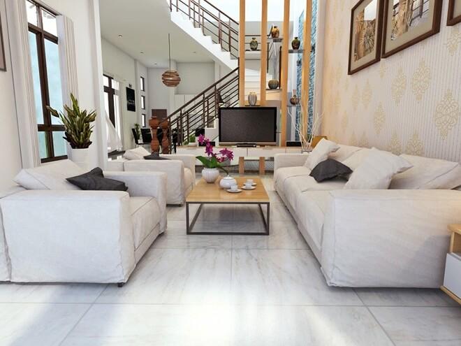 Thiết kế nhà đẹp với không gian phòng khách lớn có tông trắng sáng đúng như yêu cầu của gia chủ.