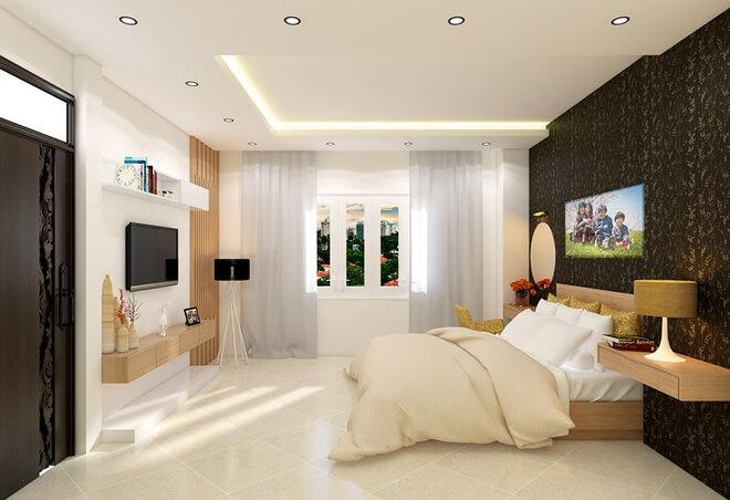 Thiết kế nhà với phòng ngủ của bố mẹ ở tầng 1. Điểm nhấn chính của phòng này là mảng tường họa tiết màu tối ở đầu giường.