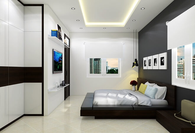 Thiết kế nhà với tông đen-trắng-xám, phòng của con trai đơn giản hơn. Tranh ảnh trang trí cũng đơn sắc nhằm thể hiện cá tính mạnh mẽ của chủ nhân.