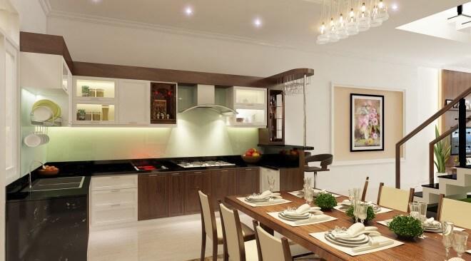 Phòng bếp gam màu trắng với một mảng tường màu xanh lá non, đẹp mát mắt, trong mẫu thiết kế nhà ống 4 tầng này.