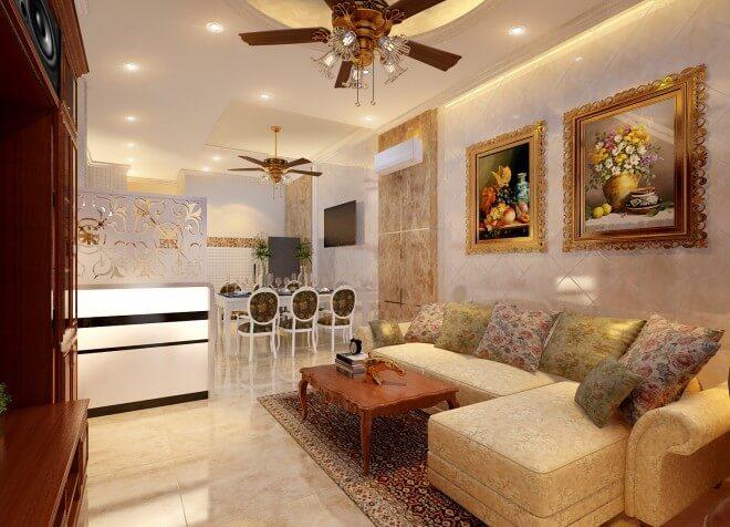 Phòng sinh hoạt chung bên trong là một không gian mở liên kết giữa bếp và phòng khách, không gian thân thiện và ấm áp hơn với tranh trang trí kết hợp ánh sáng vừa đủ