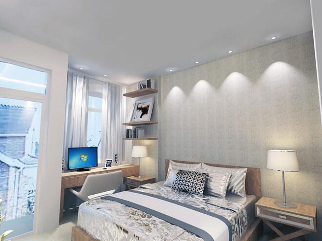 Thiết kế nhà với phòng ngủ của các con được bố trí bàn học và giá để đồ trang trí, màu sắc chăn gối nhã nhặn