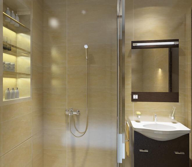 Phòng tắm sang trọng với gạch ốp tường màu vàng cùng hệ tủ âm tường nhiều ngăn tiện lợi khi sử dụng trong mẫu thiết kế nhà ống ba tầng.