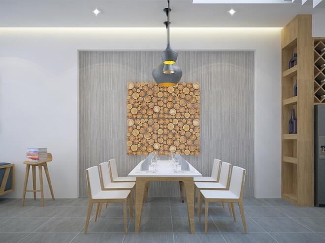 Mẫu thiết kế nhà ống 3 tầng, với khu vực bếp nằm phía sau nhà mở ra khu vườn nhỏ được trồng cây xanh.