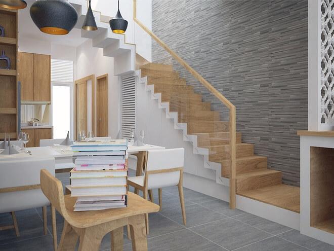 Để không gian sinh hoạt chung ở tầng 1 được rộng rãi, cầu thang được làm dọc nhà, trong mẫu thiết kế nhà ống 3 tầng này.