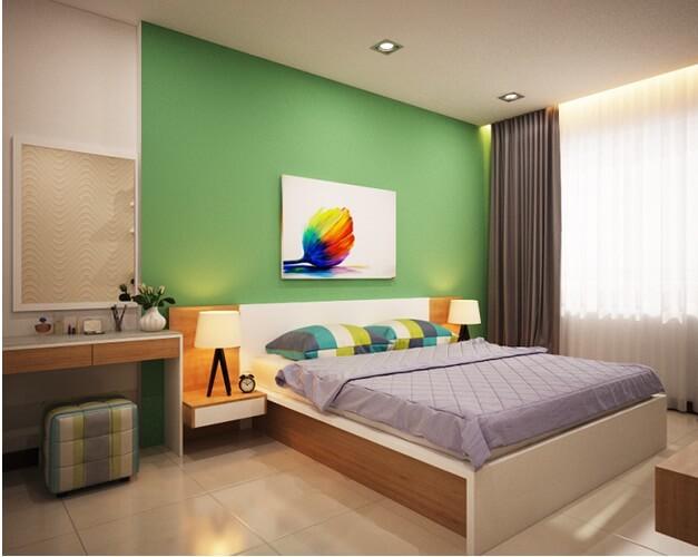 Phòng ngủ chính cũng được tận dụng mầu xanh làm điểm nhấn
