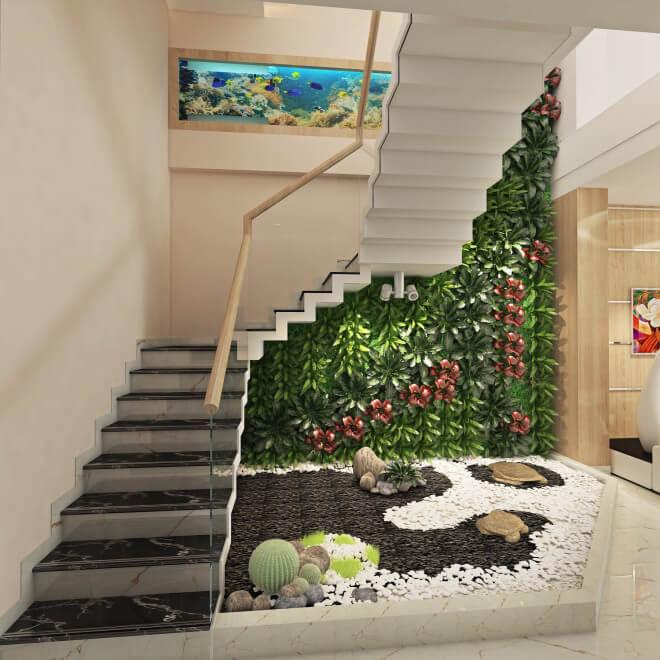 Không gian cầu thang tông trắng, thoáng sáng, duyên dáng với tường cây trang trí kết hợp tiểu cảnh.