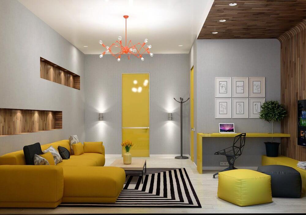 Thiết kế căn hộ với phòng khách, phòng làm việc 2 trong 1 tiết kiệm không gian với tông màu vàng - xám.