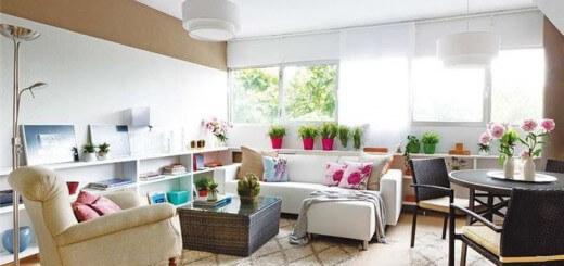 Cải tạo căn hộ với sơn trắng, phòng khách không chỉ có ưu thế về diện tích, căn hộ còn khá thoáng và sáng với hệ thống cửa sổ lắp kính giúp ánh sáng tự nhiên luôn tràn ngập căn phòng
