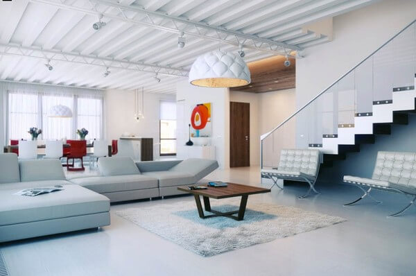 Phòng khách thoáng mát với cầu thang kính bố trí gọn gàng về một phía, sau cải tạo nhà ống