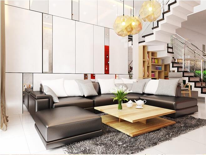 Phòng khách thiết kế đơn giản, nội thất hiện đại với những khối cạnh sắc nét và đèn chùm độc đáo làm điểm nhấn đầy ấn tượng trong mẫu nhà đẹp này.