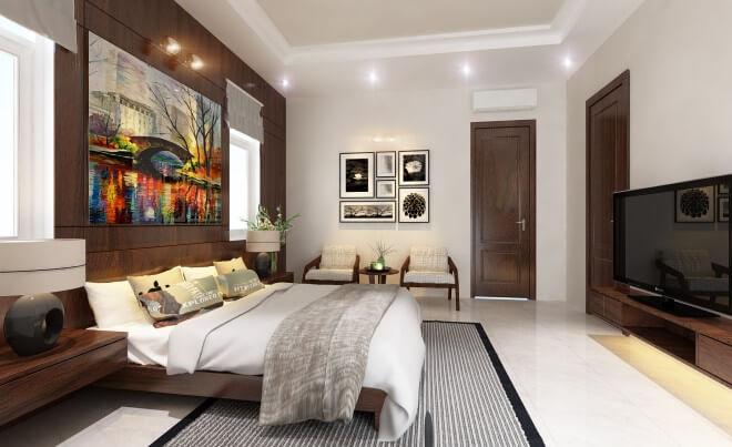 Mẫu thiết kế biệt thự với phòng ngủ master được thiết kế theo phong cách hiện đại, mảng tường gỗ tạo điểm nhấn nổi bật và sang trọng cho căn phòng.