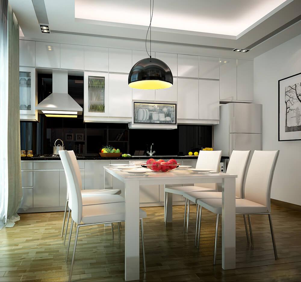 Bàn ăn màu trắng kết hợp với đèn chùm ấn tượng giúp không gian ăn uống thêm hiện đại, ấn tượng trong mẫu thiết kế nhà hai tầng này.