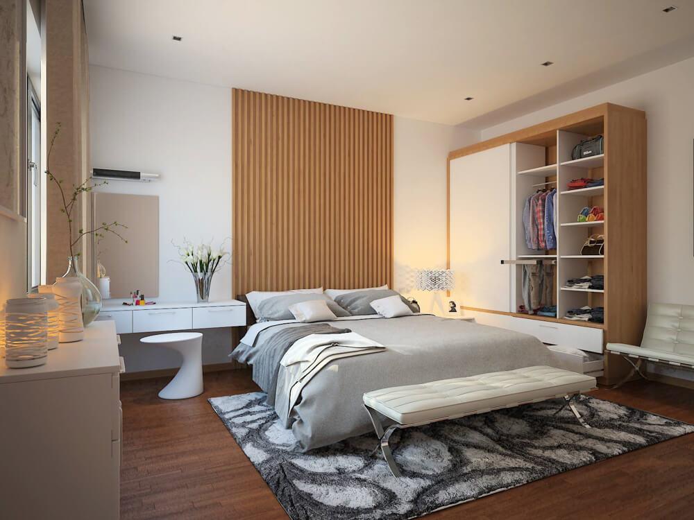 Phòng ngủ chính với gam màu trung tính và nội thất tiện nghi, sang trọng trong mẫu thiết kế nhà hai tầng này.