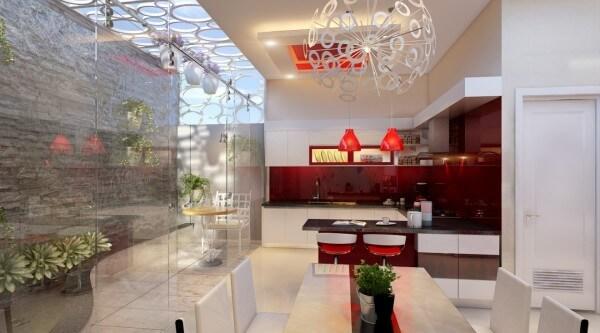 Phòng bếp màu sơn trắng chủ đạo, điểm nhấn tông đỏ để mang tới cảm giác ấm cúng hơn cho bữa cơm gia đình, đẹp trong mẫu thiết kế nhà 3 tầng.