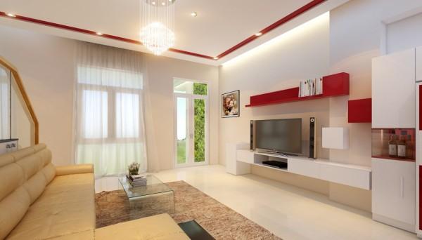 Với màu sơn trắng, phòng khách được điểm xuyết màu đỏ cá tính và nhẹ nhàng. Hệ thống ánh sáng vàng làm ấm toàn không gian, ấn tượng trong mẫu thiết kế nhà này.