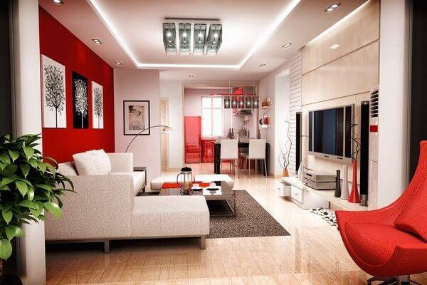 Sơn nhà rực rỡ và sáng rộng cho phòng khách với tông màu trắng chủ đạo kết hợp mảng tường đỏ tạo điểm nhấn rực rỡ cho căn phòng.