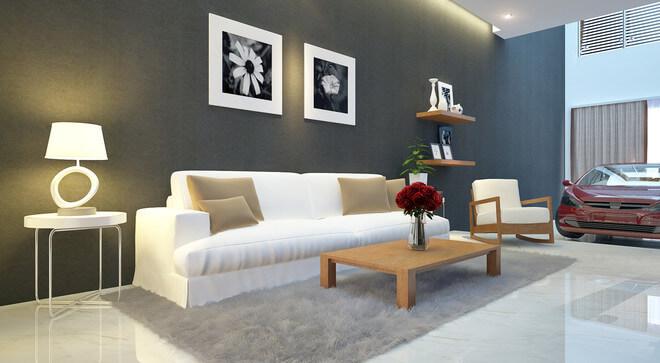 Phòng khách ấn tượng với sơn nhà mảng tường xám được tô điểm thêm bộ sofa trắng kiến tại vẻ hiện đại và chiều sâu cho không gian.