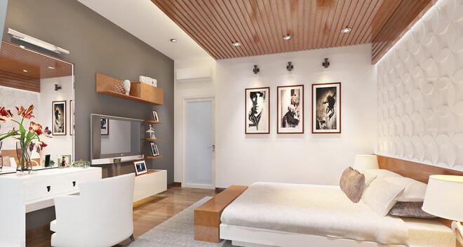 Sơn nhà với không gian phòng ngủ của gia chủ với hệ tủ sát trần màu xám. Cách bố trí này giúp tạo hiệu ứng thị giác mở rộng về chiều sâu và chiều cao.