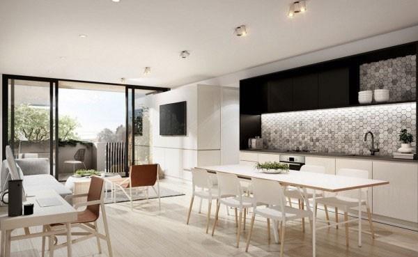 Phòng khách căn nhà chung cư sửa được chọn với sàn gỗ tươi sáng kết hợp với ánh sáng tự nhiên tạo cảm giác rộng rãi và tươi mới.