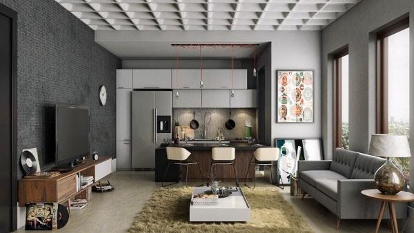 Sau khi sửa nhà chung cư, phòng khách được kết hợp với không gian bếp, với tông màu ghi xám cho căn hộ có thiết kế khá nam tính.