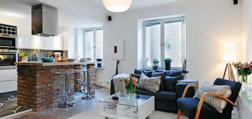 Phòng khách liên thông với bếp với gam màu trắng, tạo cảm giác rộng rãi, ấm cúng trong mẫu thiết kế căn hộ nhỏ này.