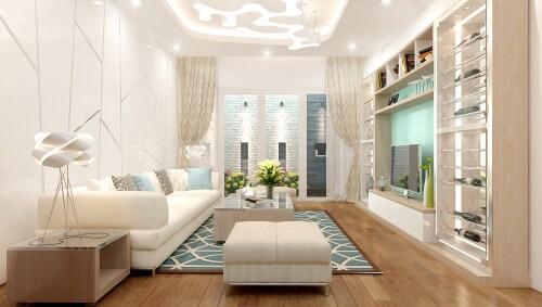 Phòng khách tông trắng kết hợp màu gỗ nhạt và mảng màu xanh tạo cảm giác thanh thoát, dịu nhẹ. Đèn trần trang trí cách điệu giúp điều tiết ánh sáng cho toàn bộ không gian, trong mẫu thiết kế nhà 4 tầng này.
