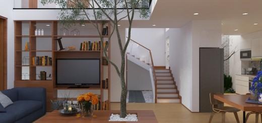 Cây xanh nằm ngay trong phòng khách, dưới giếng trời. Khu bếp dù được bố trí sau cùng, cuối hướng gió nhưng vẫn được kết nối với không gian xanh trong mẫu thiết kế nhà đẹp.