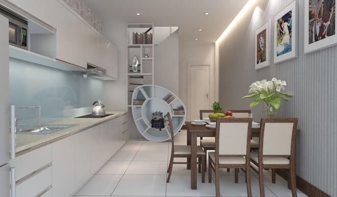 Phòng bếp trong mẫu thiết kế nhà 3 tầng này nằm ở tầng 1 được trang trí đẹp mắt với gam màu trắng, sáng rộng.