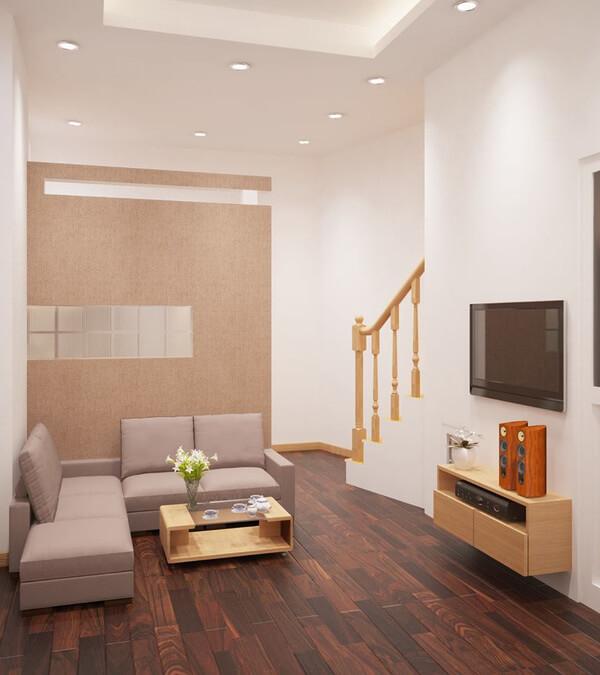 Thiết kế nhà với phòng khách gam màu trung tính, bố trí ghế sofa chữ L tiết kiệm tối đa diện tích.