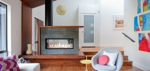 Phòng khách nhà cải tạo mới với lò sưởi được cải tạo lại trông rất đẹp. Nó gọn gàng hơn và hiện đại hơn nhiều so với trước kia.