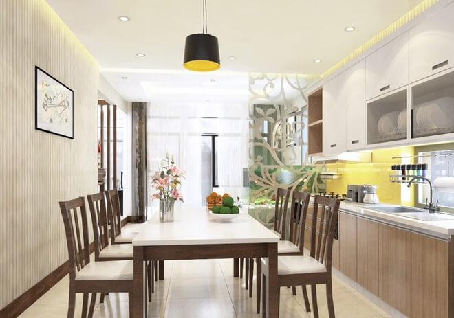 Không gian bếp nằm ở trung tâm với tông màu trung tính, ấm áp, nội thất hiện đại trong mẫu thiết kế nhà một tầng này.