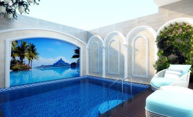 Hồ bơi gia đình được trang trí bằng tranh tường đại dương xanh, tạo cảm giác gần gũi với thiên nhiên, trong thiết kế nhà 5 tầng này.