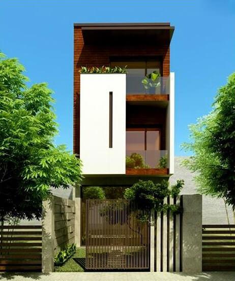 Mẫu nhà sơn đẹp với gam màu trầm và góc sân vườn nhỏ ngay cổng là không gian sống mơ ước của rất nhiều gia đình trẻ.