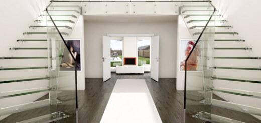 Cầu thang kính chiếm một diện tích lớn song không khiến nhà bị chật chội, khách đến chơi vẫn có thể ngắm nhìn những tác phẩm nghệ thuật treo phía sau.