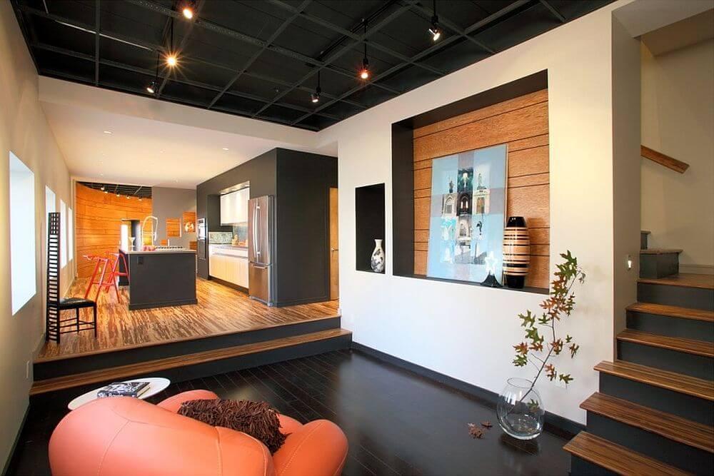 Kết hợp tuyệt vời giữa màu sắc sơn nhà tối và ánh sáng, nội thất trong không gian mở.