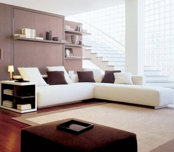 Sửa chữa cải tạo nhà với phòng khách bố trí bộ sofa chữ L có thiết kế đặc biệt phù hợp với mặt bằng căn hộ.