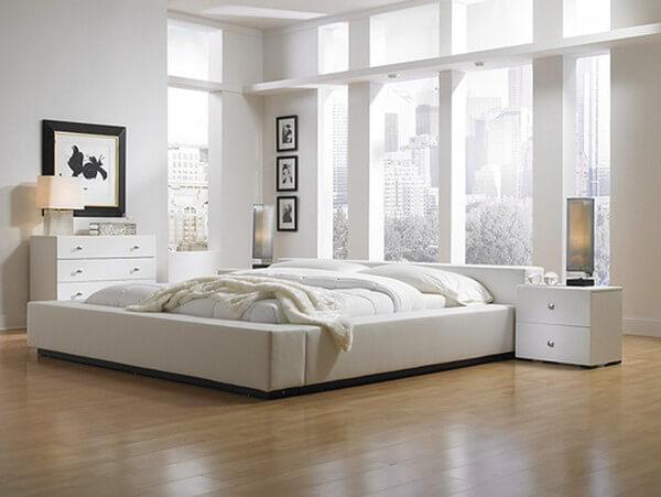 Phòng ngủ nhỏ thiết kế tối giản, sử dụng giường đơn để tiết kiệm diện tích, trong mẫu thiết kế nhà 3 tầng này.