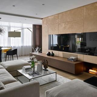 Thiết kế nhà 3 tầng, với phòng khách sử dụng bộ ghế sofa hiện đại, màu sắc trang nhã.