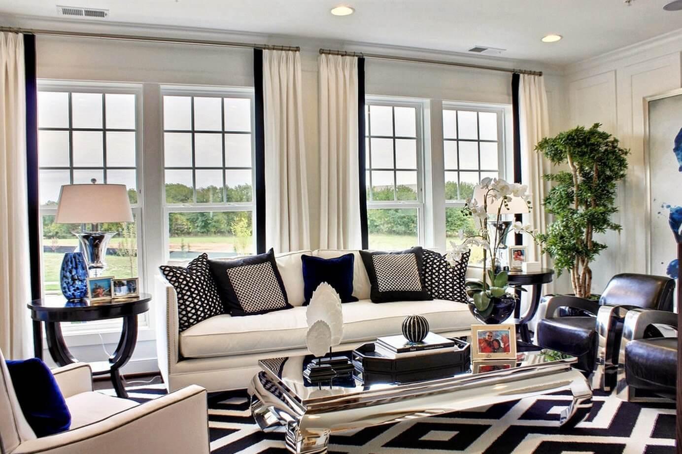 Căn phòng khách này không quá thể hiện hai gam màu khi mới nhìn lướt qua, nhưng về mặt thiết kế thì lại vô cùng đơn giản mà sang trọng.