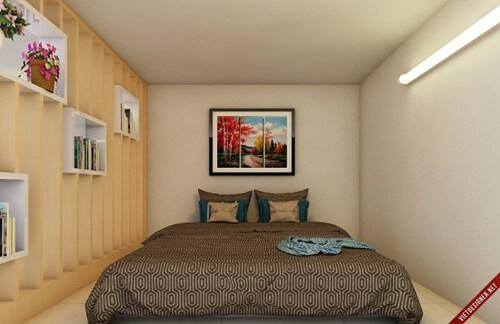 Phòng ngủ vẫn rộng rãi đủ cho 2 người, sau khi sửa chữa cải tạo nhà trọ 22 m2 này.