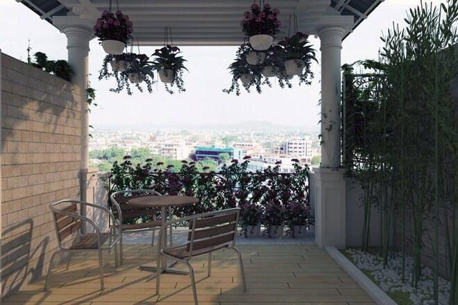 Tầng thượng được trồng cây xung quanh kèm bàn trà đúng theo thiết kế nhà 21 m2 có ba phòng ngủ sáng thoáng